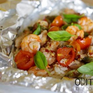 orkaitėje kepta triušiena su krevetėmis ir pomidorais